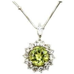 Peridot and Diamond Halo Pendant on Necklace 14 Karat White Gold