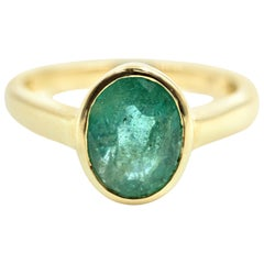 Oval Cut Emerald Solitaire Ring 14 Karat Yellow Gold