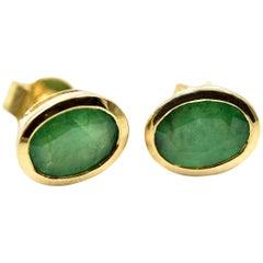 Oval Cut Emerald Bezel Set Stud Earrings 14 Karat Yellow Gold