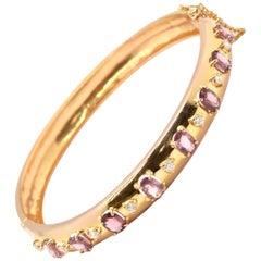 20k Yellow Gold 0.45cttw Diamond and 8.00cttw Oval Purple Sapphire Bangle Bracel
