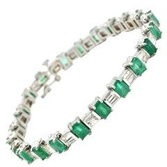 Emerald and Baguette Cut Diamond Tennis Bracelet 14 Karat White Gold