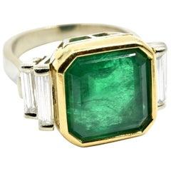 6.65 Carat Emerald and 1.00 Carat of Baguette Cut Diamonds 18k Two-Tone Ring