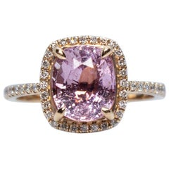 Estate Vintage 14 Karat Rose Gold Oval Pink Sapphire and Diamond Halo Ring
