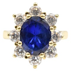 2.77 Carat Oval Cut Sapphire and Diamond Ring 10 Karat Yellow Gold