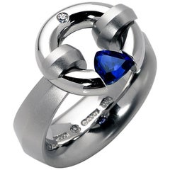 Steven Kretchmer Platinum Jazz Ring with a Tension-Set .69 ct. Blue Sapphire
