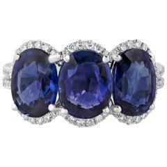 6.07 Carat Blue Sapphire and Diamond Halo Three-Stone Ring