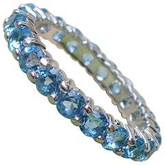 14 Karat White Gold Eternity Band with Bright Blue Aquamarine