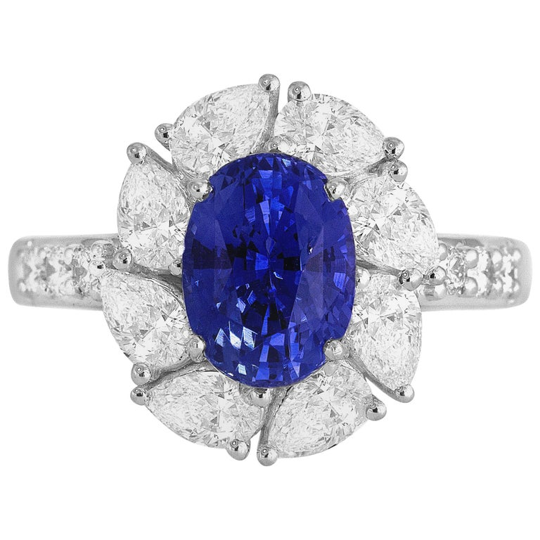 2.54 Carat Oval Cut Vivid Blue Ceylon Sapphire and Diamond Ring in White Gold For Sale