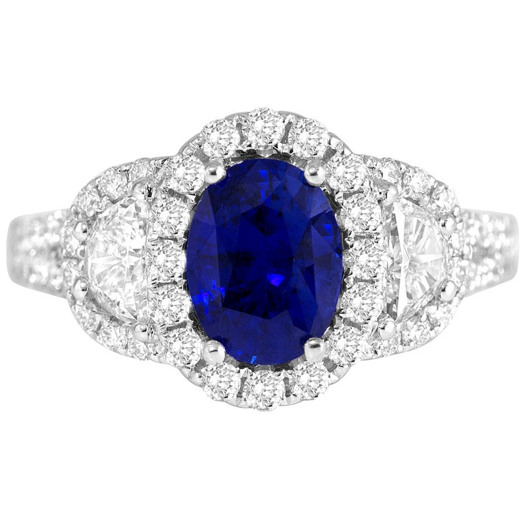 2.26 Carat Oval Cut Vivid Blue Ceylon Sapphire and Diamond Ring in White Gold For Sale