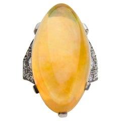 Art Deco 14.75 Carat Orange Ethiopian Opal Cabochon and Diamond Platinum Ring