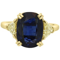 GIA Certified 4.39 Carat Blue Sapphire Cushion Yellow Diamond Three-Stone Ring