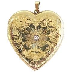 Engraved Heart Shaped Locket with Center Diamond or 14 Karat