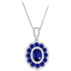 1.91 Carat Blue Sapphire and White Diamond Flower Pendant in 18 Karat White Gold