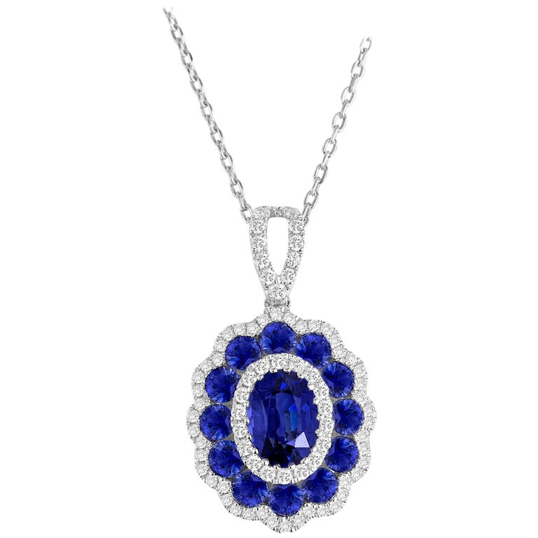 1.91 Carat Blue Sapphire and White Diamond Flower Pendant in 18 Karat White Gold For Sale