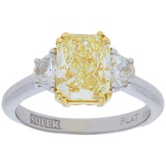GIA Certified 2.67 Carat Fancy Yellow Radiant Diamond Three Stone Ring