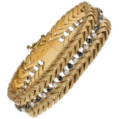 Classic 14 Karat Yellow Gold White Diamond, Sapphire Flexible Link Bracelet