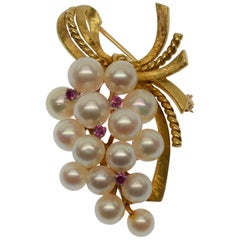 Boutique of Pearls & Rubies with a 14 Karat Yellow Gold Ribbon Brooch