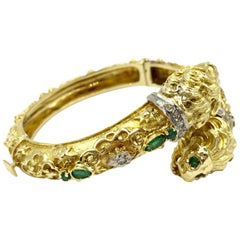 Retro 18 Karat Carved Lion Bangle with Diamonds and Emeralds