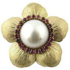 14 Karat Yellow Gold Mobe Pearl and Ruby Flower Pendant