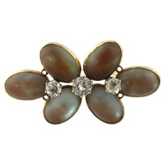 Antique Victorian 14 Karat Yellow Gold Moonstone and Spinel Flower Brooch Pin