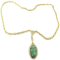14 Karat Yellow Gold and Carved Jade Necklace