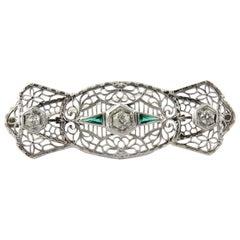 Antique 14 Karat White Gold Art Deco Diamond and Emerald Filigree Brooch Pin