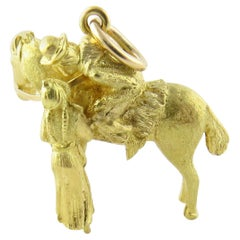 18 Karat Yellow Gold Horse with Soldier and Sweetheart Pendant