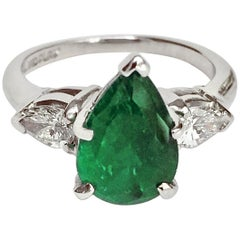 Platinum Emerald and Diamond Engagement Ring Three-Stone Pear Shape
