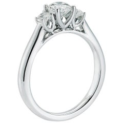 Round diamond three stone engagement ring with 1.09 G VS2 GIA Center in Platinum