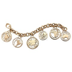 Monica Rich Kosann Continent 18K Yellow Gold Charm Bracelet featuring 6 charms