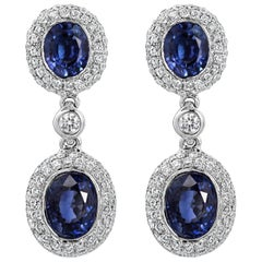 Oval Cut Blue Sapphire and Diamond Dangle Earrings