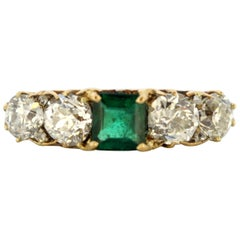Exceptional 18 Karat Yellow Gold Ring with Emerald and Diamonds, circa 1950s