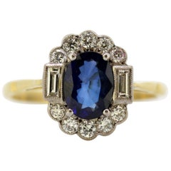 Vintage 18 Karat Gold Ladies Ring with Blue Sapphire and Diamonds, circa 1970