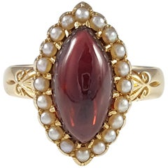 Edwardian 18 Karat Yellow Gold Garnet and Seed Pearl Cluster Ring