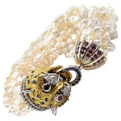 "Diamond, Ruby and Sapphire ""Fudog"" Pearl 18 Karat Yellow Gold Bracelet"