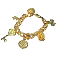 14 Karat Gold Charm Bracelet Key Coin Heart Scale and More