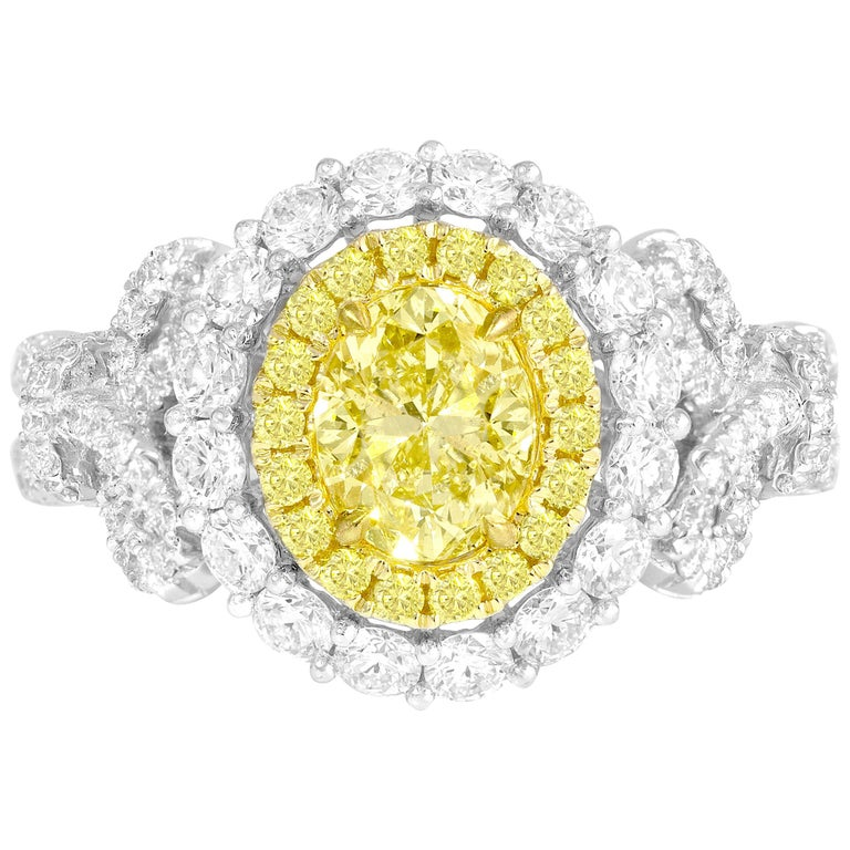 GIA Certified 0.98 Carat Oval Cut Natural Fancy Intense Yellow SI1 Diamond Ring For Sale