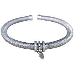 White Gold and 0.16 Carat Diamonds Semi-Rigid Bangle Bracelet