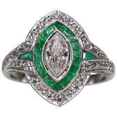 Antique Art Deco Platinum Diamond and Emerald Ring