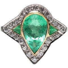Modern Art Deco Style Platinum 1.86 Carat Emerald and Diamond Ring