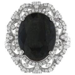 GIA Certified 8.49 Carat Oval Dark Greenish Blue Sapphire and Diamond Ring