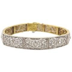 Art Deco 1920s 18 Carat Yellow Gold and Platinum 1.20 Carat Diamond Bracelet