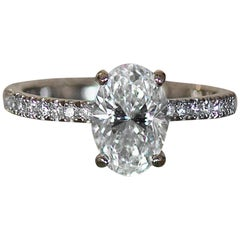 Oval Diamond Engagement Ring, Set in 18 Karat White Diamonds Down Shank
