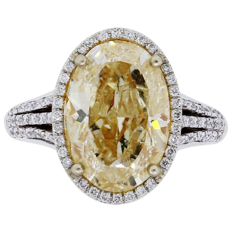 6.34 Carat Fancy Yellow Oval Cut Diamond Engagement Ring For Sale