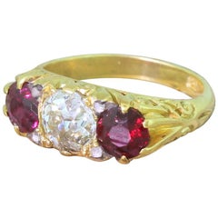 Victorian Old Cut Diamond and Ruby Carved Trilogy Ring