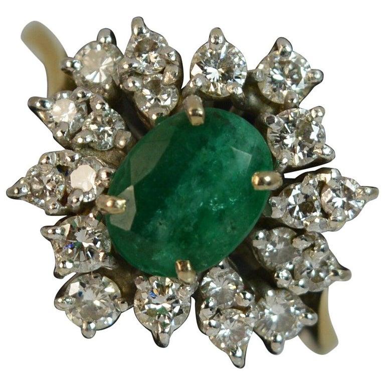 0.70 Carat Diamond and Emerald 18 Carat Gold Cluster Ring