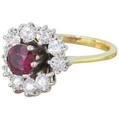 Late 20th Century 0.63 Carat Ruby and 0.75 Carat Diamond Cluster Ring