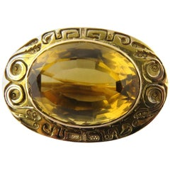 10 Karat Yellow Gold Bezel Set Large Oval Citrine Brooch with Hand Engraved Rim