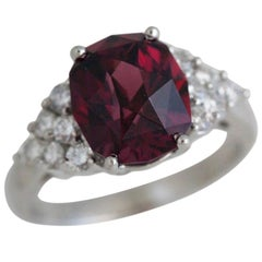 Fancy Oval Rhodolite Garnet Ring Set in Diamond and Platinum
