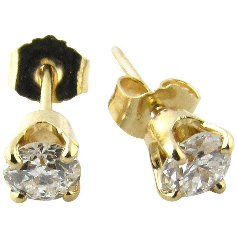 14 Karat Yellow Gold Diamond Stud Earrings .60 Carat For Sale